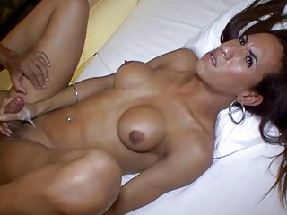 Busty tranny sprays big load while being ass banged hard