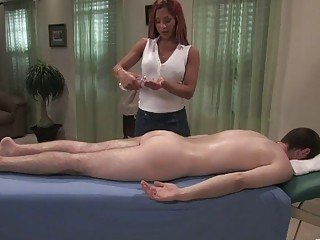 Busty shemale massages a guy stud before sucking him off