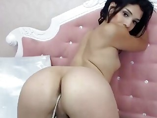 Cute naked tattooed shemale enjoys masturbation and playing with herself