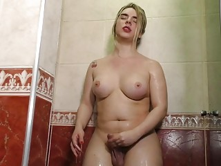 Gorgeous chubby shemale Carol Penelope jerks off in the shower