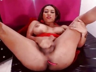 Horny ladyboy has her ass vibrating while wanking on webcam